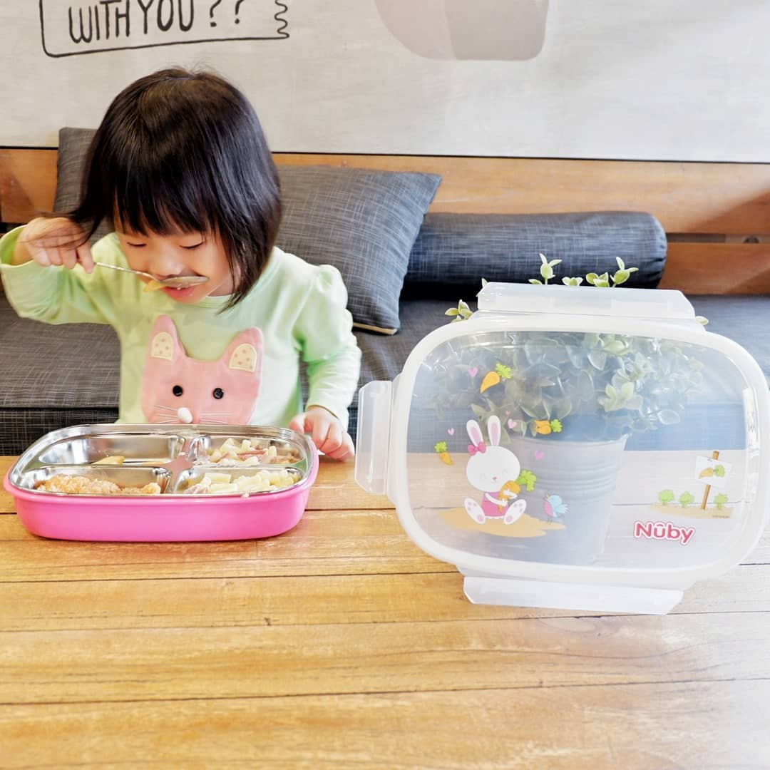 nuby insulated stainless steel lunchbox in use
